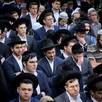 Ultra Orthodox Jews attend the funeral of Abraham Ambon in Jerusalem on May 3, 2021. Amnon was one of the victims of the Meron disaster, where 45 people were crushed to death during a Lag b'Omer celebration. (Yonatan Sindel/Flash90)