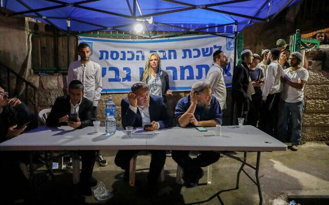 MK Itamar Ben Gvir seen with Lehava chairman Benzi Gopstein in the East Jerusalem neighborhood of Sheikh Jarrah on May 6, 2021. (Olivier Fitoussi/Flash90)