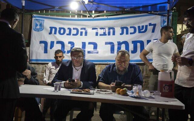 MK Itamar Ben Gvir seen with Lehava chairman Benzi Gopstein in the East Jerusalem neighborhood of Sheikh Jarrah on May 6, 2021 (Olivier Fitoussi/Flash90)