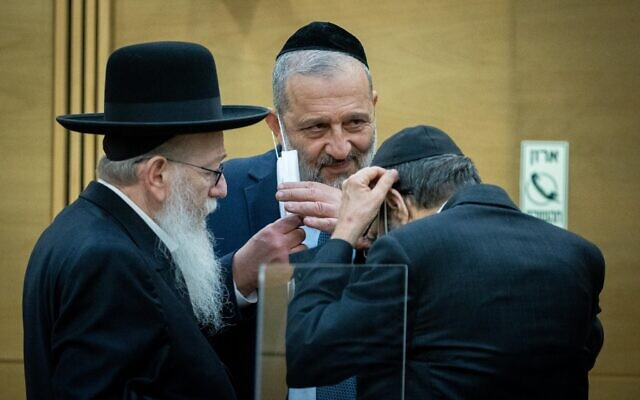 Haredi party leaders Aryeh Deri of Shas, center, and Yaakov Litzman, left, and Moshe Gafni of United Torah Judaism, at a press conference at the Knesset in Jerusalem, on May 6, 2021. (Yonatan Sindel/Flash90)
