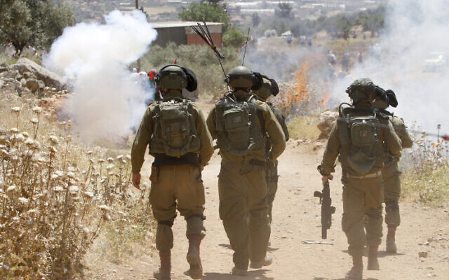 Israeli soldiers clash with Palestinians during a protest in the village of Beit Dajan, near the West Bank city of Nablus on May 7, 2021 (Nasser Ishtayeh/Flash90)