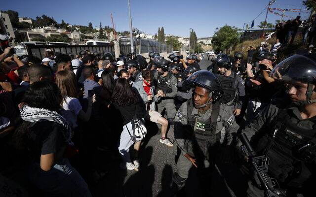 Police clash with protesters demonstrating against the pending eviction of several Palestinian families in the East Jerusalem neighborhood of Sheikh Jarrah on May 7, 2021. (Yonatan Sindel/Flash90)