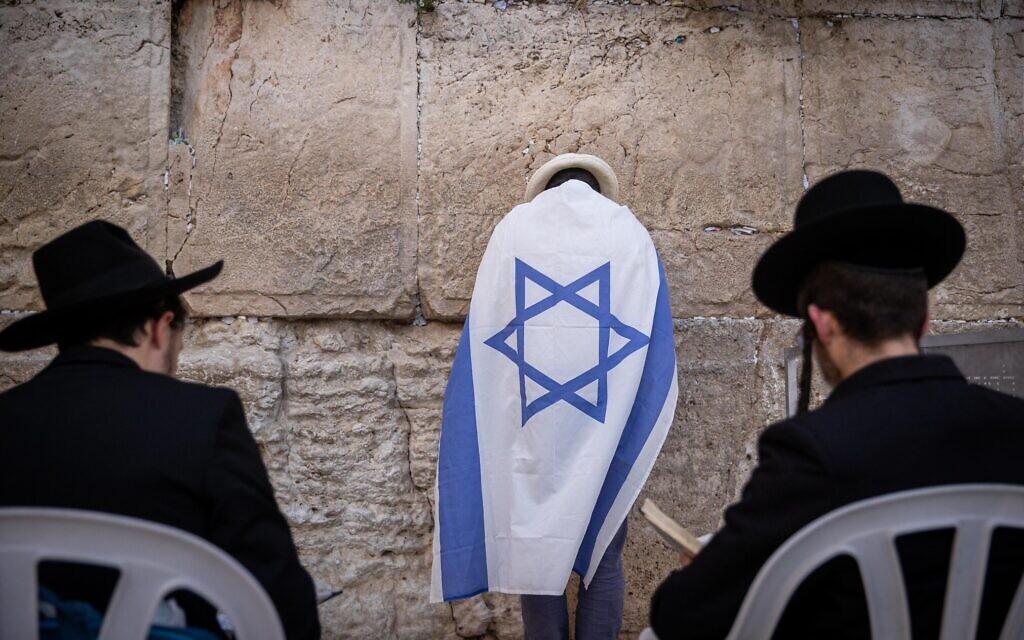 Jewish men pray at the Western Wall in Jerusalem Old City on the eve of Jerusalem Day, May 09, 2021. (Yonatan Sindel/Flash90)