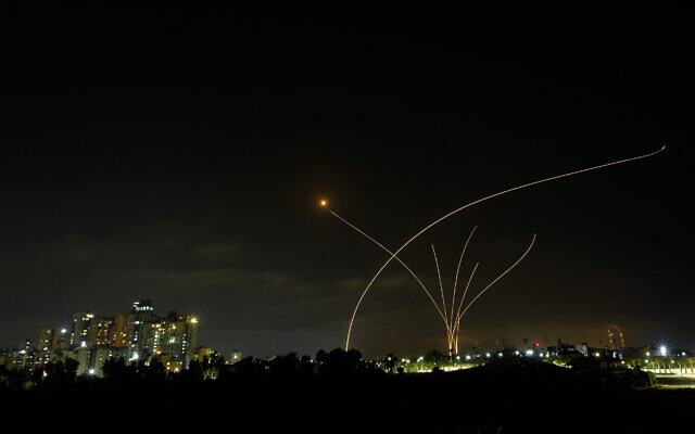 A long exposure picture shows Iron Dome anti-missile system fire as rockets are launched from the Gaza Strip, Ashkelon, May 10, 2021. (Edi Israel/Flash90)