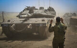 IDF Armored Corps soldiers prepare to move south to the Gaza border on May 11, 2021, at El Poran, Golan Heights. (Michael Giladi/Flash90)
