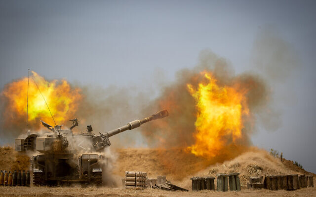 IDF Artillery Corps fires into Gaza, near the Israeli border on May 12, 2021, following heavy rocket and missile barrage fired into Israel by terrorists in Gaza. (Yonatan Sindel/Flash90)