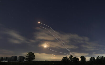 A long exposure picture shows Iron Dome interception missiles fired as rockets are launched from the Gaza Strip to Israel, May 13, 2021. (Noam Revkin Fenton/Flash90)