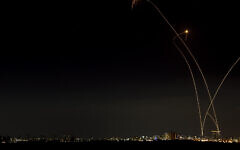 A long exposure picture shows an interception by the Iron Dome anti-missile system over the southern Israeli city of Ashkelon, May 14, 2021. (Avi Roccah/Flash90)