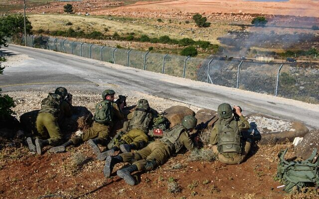 Israeli soldiers guard in Metula, on the border between Israel and Lebanon, northern Israel, on May 14, 2021, after Lebanese protesters crossed the Israeli border fence. (Basel Awidat/Flash90)