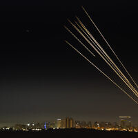 A long exposure picture shows the Iron Dome anti-missile system firing interception missiles as rockets are fired from the Gaza Strip to Israel, over the southern Israeli city of Ashkelon, May 16, 2021. (Avi Roccah/Flash90)
