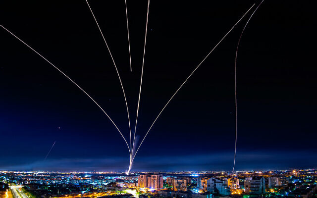 A long-exposure picture shows Iron Dome anti-missile system fire to intercept rockets launched from the Gaza Strip at Israel, as seen from the southern Israeli city of Ashdod, May 16, 2021. (Avi Roccah/Flash90)