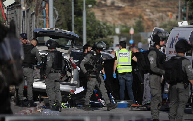 Police at the scene of a car ramming attack in the Sheikh Jarrah neighborhood of East Jerusalem, on May 16, 2021. (Yonatan Sindel/FLASH90)