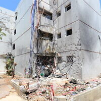 An apartment building in the southern city of Ashdod is seen on May 18, 2021, after it was damaged by a rocket fired by Palestinian terrorists in the Gaza Strip, lightly hurting several people. (Avi Roccah/Flash90)