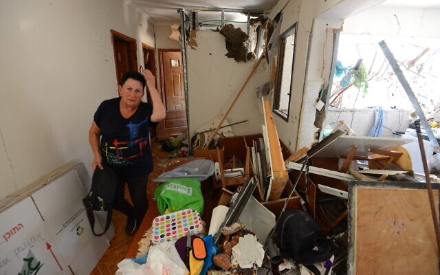An Israeli in her home after a rocket hit from the Gaza Strip, in the southern city of Ashdod, on May 18, 2021. (Avi Roccah/Flash90)