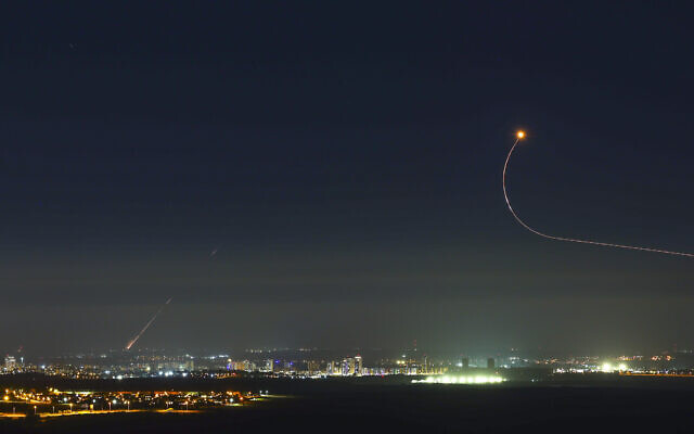 Rockets fired by Hamas terrorists in Gaza into Israel, seen over the central Israeli town of Kiryat Gat on May 18, 2021. (Nati Shohat/Flash90)
