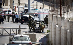 Israeli security forces at the site where a Palestinian tried to attack soldiers before he was shot by troops, May 18, 2021. (Wisam Hashlamoun/Flash90)