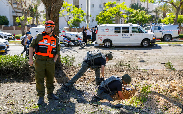 Israeli security forces at the scene where part of a rocket fired from the Gaza Strip landed in the southern port city of Ashdod, May 19, 2021. (Flash90)