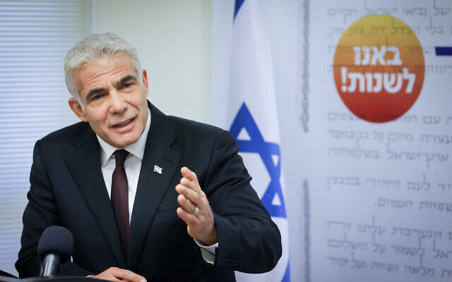 Yesh Atid party chief Yair Lapid leads a faction meeting at the Knesset on May 24, 2021. (Olivier Fitoussi/Flash90)
