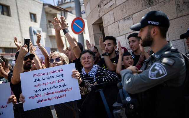 Palestinians protest outside the District Court in Jerusalem against Israel's plan to evict Palestinians in the East Jerusalem neighborhood of Silwan, on May 26, 2021. (Yonatan Sindel/Flash90)