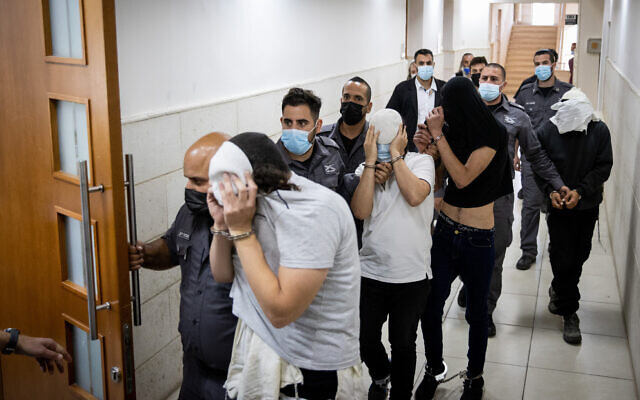 Four Jewish suspects accused of stabbing an Arab man at the Mahane Yehuda market are brought to the Jerusalem District Court for a hearing, May 30, 2021. (Yonatan Sindel/Flash90)