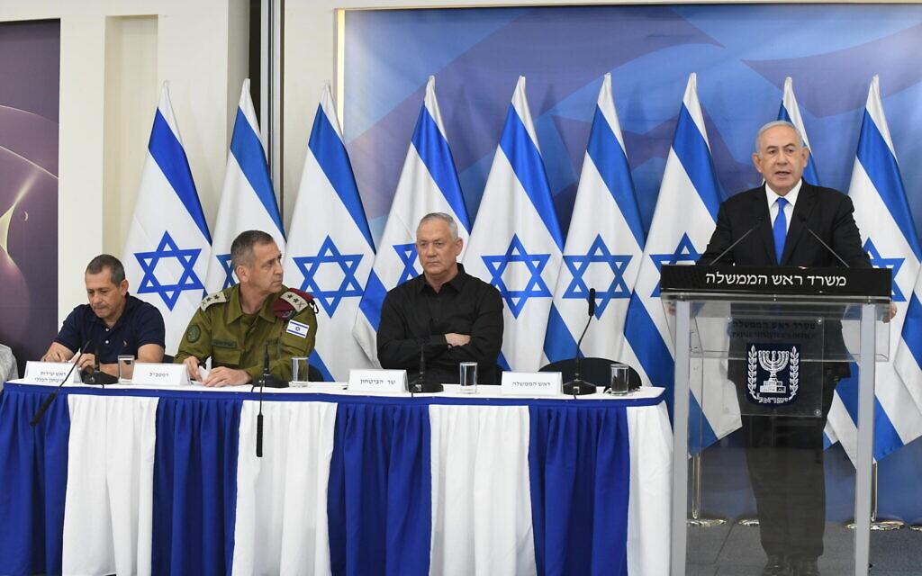 From left: Shin Bet chief Nadav Argaman, IDF chief Aviv Kohavi, Defense Minister Benny Gantz and Prime Minister Benjamin Netanyahu, at a press conference after the Gaza ceasefire, Tel Aviv, May 21, 2021. (Amos Ben Gershom/GPO)