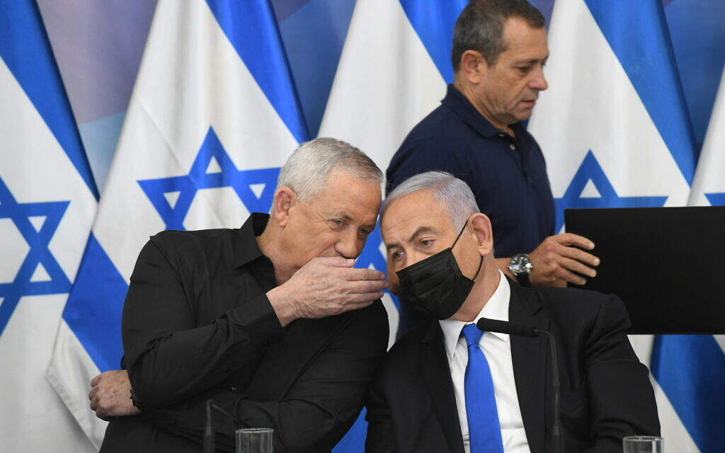 Defense Minister Benny Gantz, Prime Minister Benjamin Netanyahu and, behind them, Shin Bet chief Nadav Argaman, at a press conference after the Gaza ceasefire, Tel Aviv, May 21, 2021. (Amos Ben Gershom/GPO)