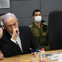 Defense Minister Benny Gantz and Prime Minister Benjamin Netanyahu during a consultation amid Hamas rocket fire at Israel and IDF counterstrikes, May 11, 2021. (Amos Ben Gersom / GPO)