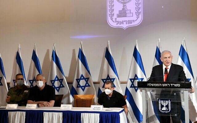Prime Minister Benjamin Netanyahu addresses Israel after unprecedented Hamas rocket fire on central Israel, May 11, 2021. Also present, from left: IDF chief of staff Aviv Kohavi; Defense Minister Benny Gantz and Shin Bet chief Nadav Argaman (Amos Ben-Gershom / GPO)