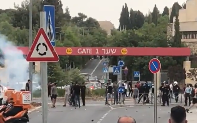 Palestinians and police clash outside the Mount Scopus campus of the Hebrew University of Jerusalem on May 9, 2021. (Screen capture: Twitter)