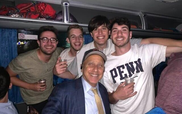 Josh Vlessing (right) with friends on a bus to Mt. Meron organized by Jeff Seidel (front center), April 29, 2021. (Courtesy Josh Vlessing)