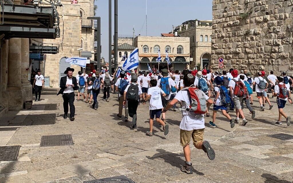 Israelis stream into Jerusalem's Old City through the Jaffa Gate during the annual flag march on May 10, 2021 (Sarah Tuttle-Singer/Times of Israel)