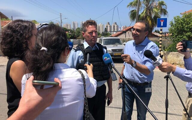 Israel Police's Micky Rosenfeld speaks in Ashkelon, May 12, 2021 (Courtesy)