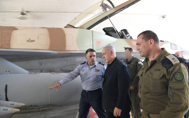 Prime Minister Benjamin Netanyahu visits the Israel Air Force base at Hatzerim, May 18, 2021. With him are Air Force chief Amikam Norkim (left) and deputy IDF chief of staff Eyal Zamir (Kobi Gideon / GPO)