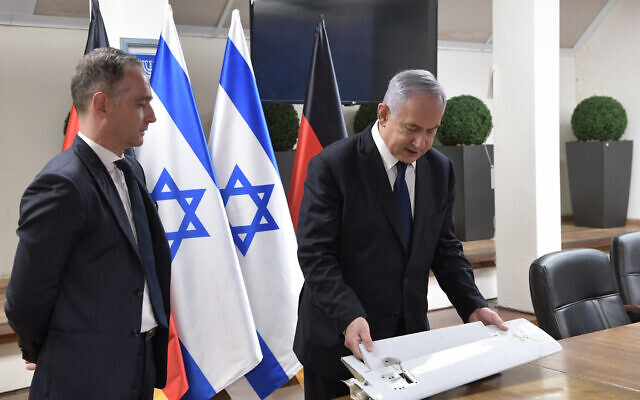 Prime Minister Benjamin Netanyahu, right, shows visiting German Foreign Minister Heiko Maas fragments of a drone that Israel says was launched by Iran toward northern Israel, which was brought down by the Israeli military, on May 20, 2021. (Kobi Gideon/Government Press Office)