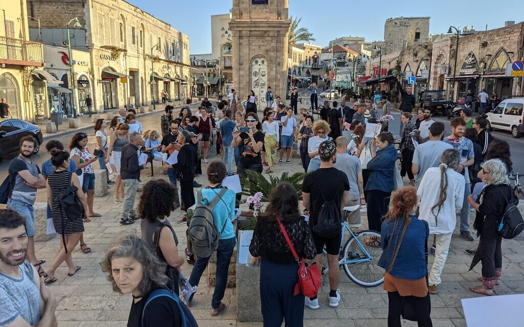 Demonstrators gather to display coexistence at the Jaffa clock tower square, May 13, 2021. (Elie Bleier)