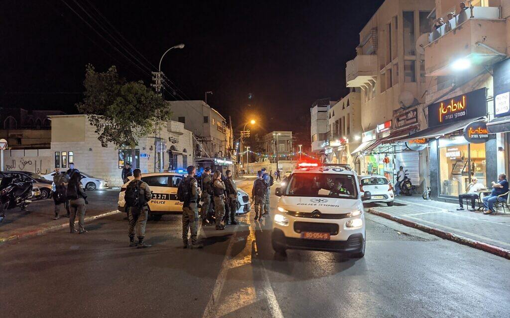 Police checkpoint on Yefet Street in the heart of Ajami, May 19, 2021. (Elie Bleier)