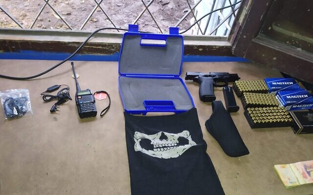 Police found Nazi literature, weapons and other troubling objects during a raid in Tucuman, Argentina. (Tucuman Federal Prosecutor No. 2 via JTA)