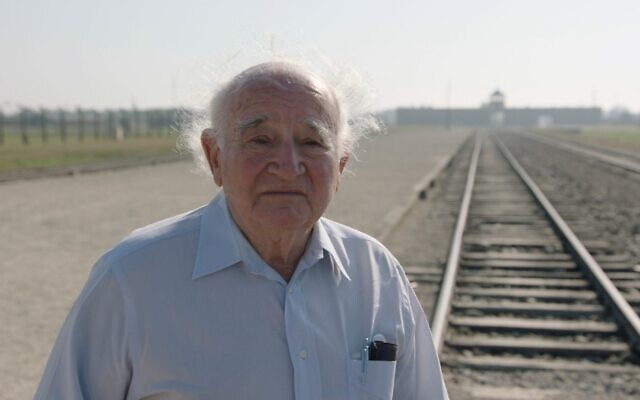 Roman Kent stands outside Auschwitz. (Courtesy of Jewish Foundation for the Righteous via JTA)