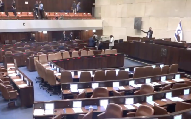 The Knesset plenum clears following a rocket alert on May 10, 2021. (Screen capture/Twitter)