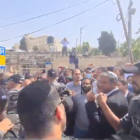 Religious Zionism MKs are guarded by police as they arrive at the Sheikh Jarrah neighborhood on May 10, 2021. (Screen capture/Twitter)