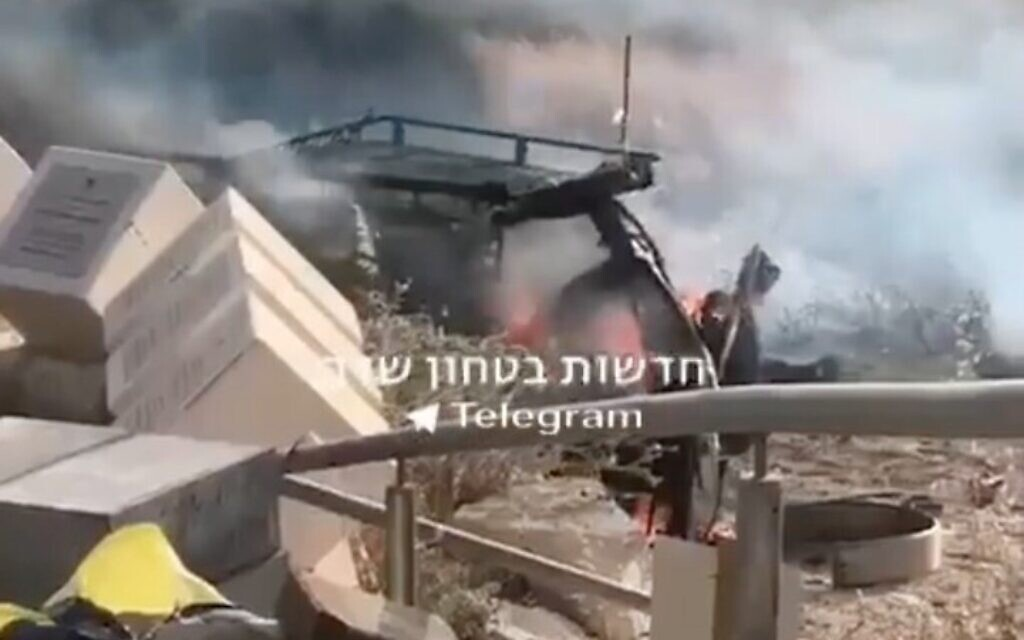 An Israeli car on fire near the Gaza border after being hit by a rocket fired from the Gaza Strip, May 10, 2021 (Facebook screenshot)