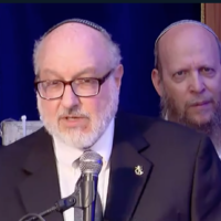 Jonathan Pollard speaks at the Mercaz Harav yeshiva Jerusalem Day gala on May 10, 2021. (Screen capture/YouTube)