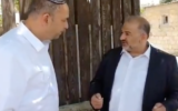 Ra'am party chief Mansour Abbas meets with Lod Mayor Yair Revivo on Sunday, May 17, 2021 (screenshot: Kan)