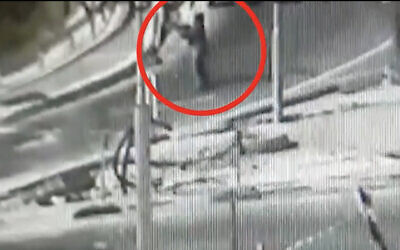 In security video released by the Israel Defense Forces, a Palestinian woman can be seen firing toward the entrance to the West Bank settlement of Kiryat Arba on May 19, 2021. (Screen capture)