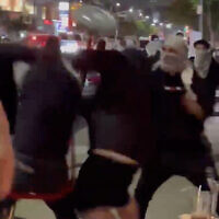 Pro-Palestinian demonstrators assault Jews at a sushi restaurant in Los Angeles on May 19, 2021. (Screen capture: Twitter)