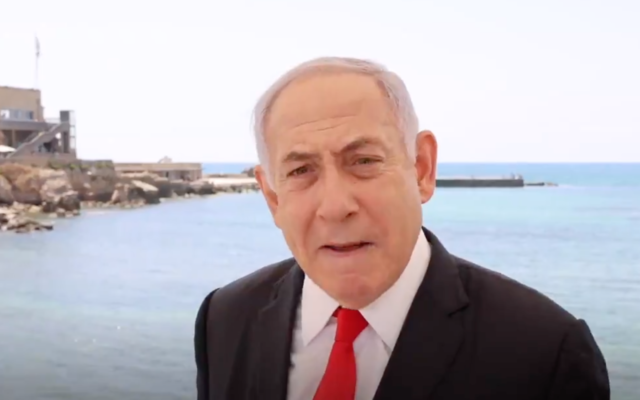 """Prime Minister Benjamin Netanyahu speaks in Caesarea on May 28, 2021, imploring right-wing political rivals not to join a """"left-wing government"""" with Yesh Atid's Yair Lapid. (Screen capture/Twitter)"""
