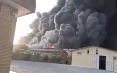 Heavy black smoke rises from Movaledan chemical factory in the vicinity of Qom, one of Iran's prominent religious cities on May 2, 2021. (Screen capture: Twitter)