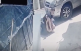 Screenshot of a video where an Israeli security guard beats a Palestinian man in East Jerusalem neighborhood of Silwan, posted on April 29 2021. (Screen capture: Wadi Hilweh Information Center/ Twitter)