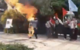 Screenshot from a video being shared on social media said to depict an Iranian met accidentally setting himself alight after attempting to burn an Israeli flag, posted on May 8 2021. (Screen capture: Twitter)