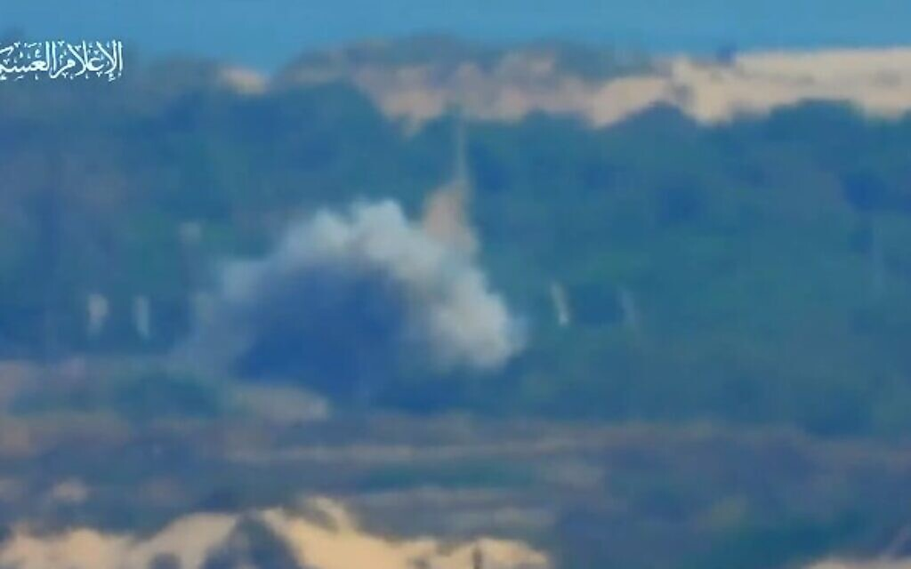 A screenshot of a video released by the Hamas terror group showing an anti-tank missile hitting an IDF bus near the Gaza border, May 20, 2021. (Screen capture: Twitter)
